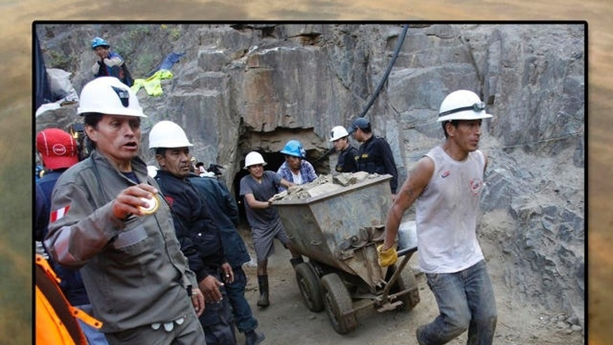 April 7, 2012: People work in a collapsed mine to rescue trapped miners in Ica, Peru.