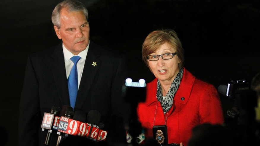 Florida Dept. of Law Enforcement agent Joyce Dawley, right, and Seminole County Sheriff Donald Eslinger talk to the media outside the Seminole County jail after delivering George Zimmerman Wednesday April 11, 2012, in Sanford, Fla. (AP Photo/Chris O'Meara)