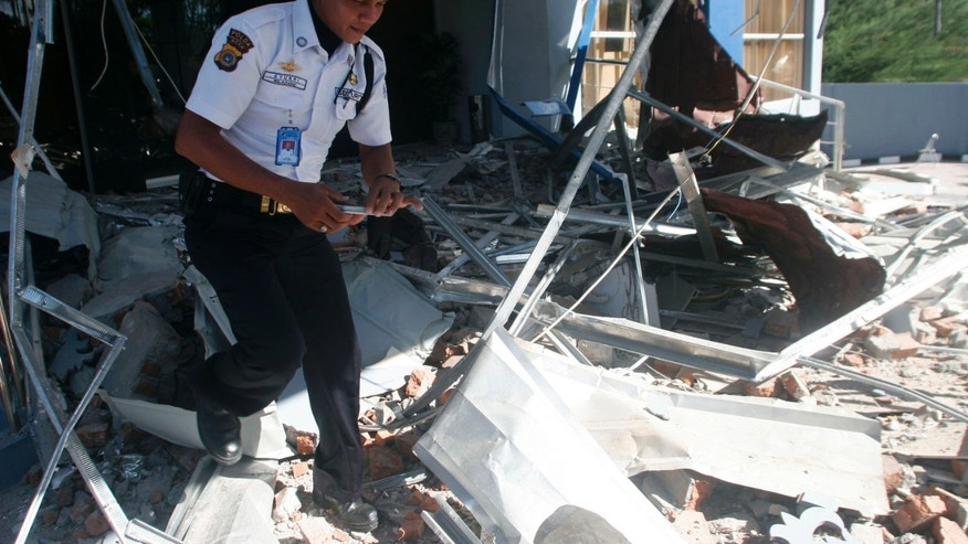 April 12, 2012: A security officer walks through debris from Wednesday's strong earthquake at an office building in Banda Aceh, Aceh province, Sumatra island, Indonesia, Thursday.