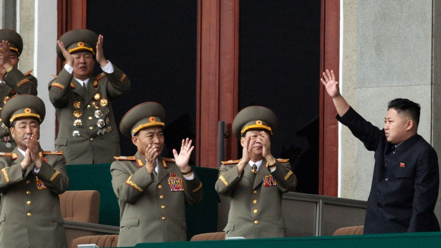 April 14, 2012: North Korean leader Kim Jong Un, left waves as North Korean military officers clap in a stadium in Pyongyang during a mass meeting called by the Central Committee of North Korea's ruling party on Saturday.