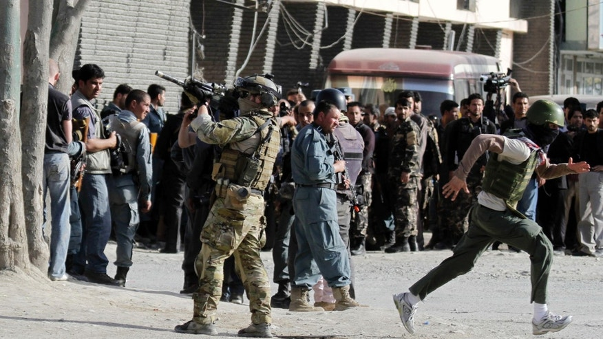 April 15, 2012: A NATO soldier stands guard at the scene of a attack by Taliban militants in Kabul, Afghanistan. The Taliban launched a series of coordinated attacks on at least seven sites across the Afghan capital on Sunday, targeting NATO headquarters, the parliament and diplomatic residences. Militants also launched near-simultaneous assaults in three other eastern cities.