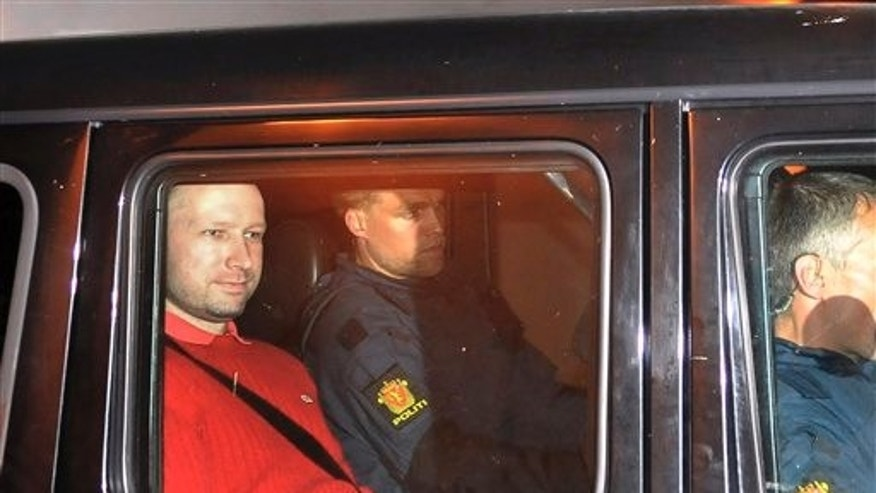 July 25, 2011: Norway's twin terror attacks suspect Anders Behring Breivik, left, sits in an armored police vehicle after leaving the courthouse following a hearing in Oslo, Norway where he pleaded not guilty to one of the deadliest modern mass killings in peacetime. (AP Photo/Aftenposten/Jon-Are Berg-Jacobsen)