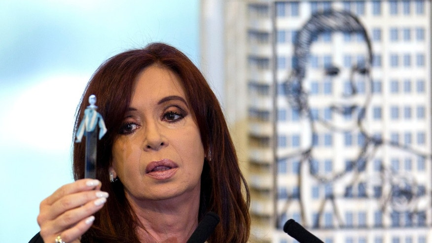April 16: Argentina's President Cristina Fernandez holds up a tube with a sample of the first oil extracted in the country, during her announcement of a bill to nationalize Spain's controlled oil company YPF, at Government House in Buenos Aires, Argentina.