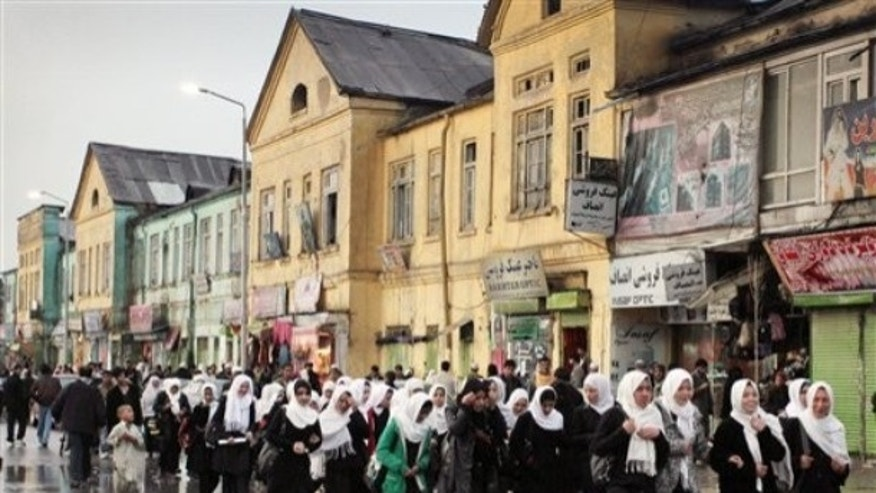 April 1, 2012: Afghan school girls walk home after class in downtown Kabul, Afghanistan, Sunday.
