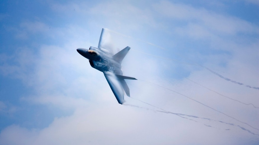 ANDREWS AFB, MD  - MAY 16:  A F-22 flies during the Joint Services Open House and Air Show May 16, 2008 at Andrews Air Force Base in Maryland.  Military families, their guests and students attended the show, which opens to the public this weekend, featuring demonstrations by the U.S. Navy's Blue Angels and others.  (Photo by Brendan Smialowski/Getty Images)