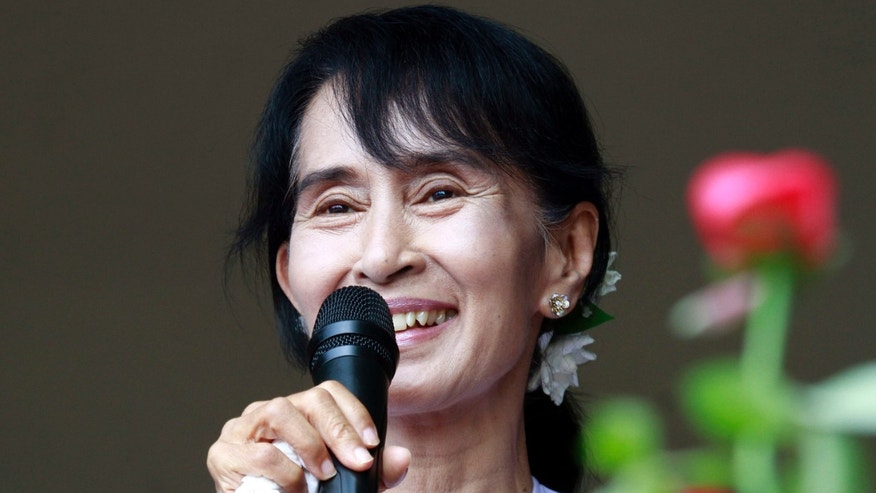 April 2, 2012: Myanmar pro-democracy leader Aung San Suu Kyi talks to supporters at the headquarters of her National League for Democracy party in Yangon, Myanmar.