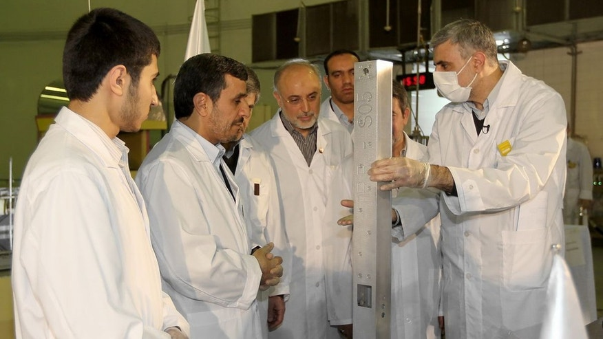 Feb. 15, 2012: This photo, released by the Iranian President's Office, claims to show Iranian President Mahmoud Ahmadinejad, second left being escorted by technicians during a tour of Tehran's research reactor centre in northern Tehran, Iran.