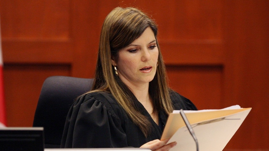 Circuit Judge Jessica Recksiedler holds a status hearing Friday, April 13, 2012, in Sanford, Fla., in the second-degree murder case against neighborhood watch volunteer George Zimmerman. Attorneys are asking for a bond hearing next Friday and for the judge to remove herself from the case because her husband is a member of a law firm whose founder is a legal analyst on television. Zimmerman has been charged in the shooting death of Trayvon Martin on Feb. 26, in Sanford. (AP Photo/Orlando Sentinel, Tom Benitez, Pool)