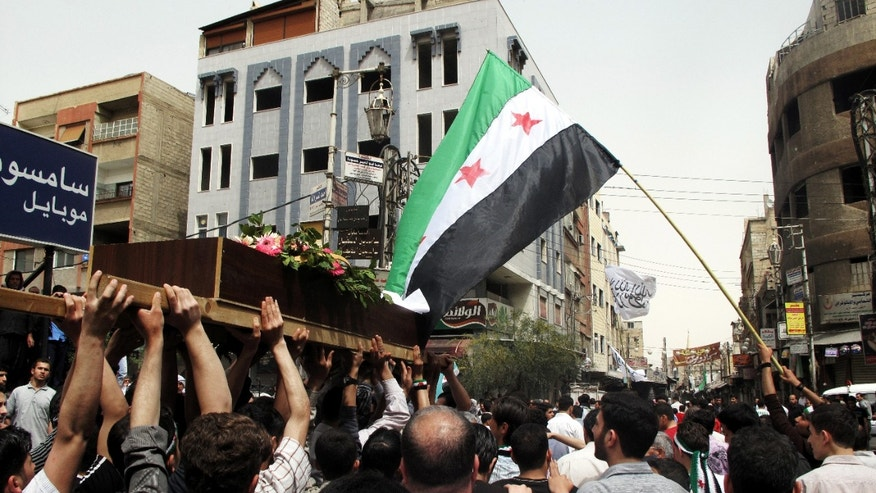 April 18, 2012: In this photo, Syrian mourners carry the body of Rama Saada, 9, who was shot by Syrian forces in Douma, Damascus, Syria.