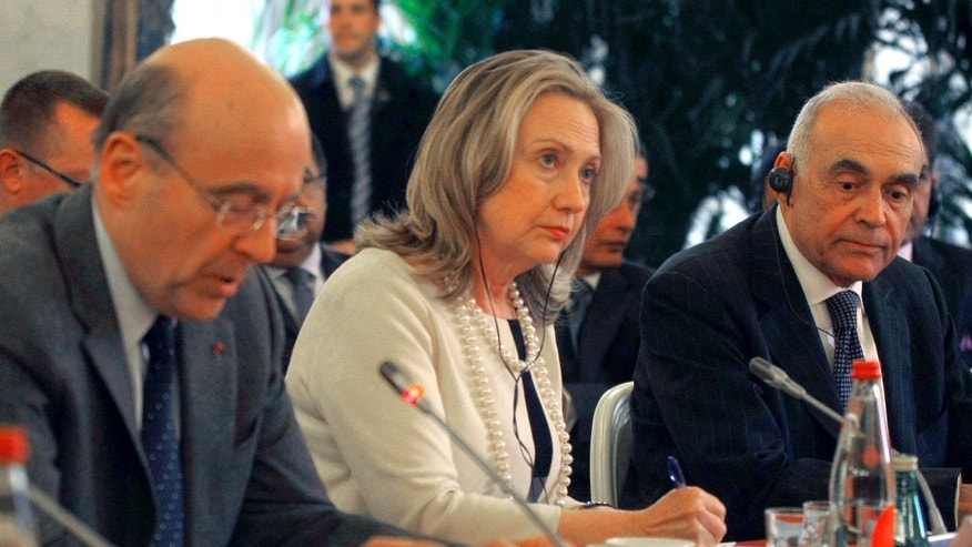April 19: From left, France's foreign minister Alain Juppe, U.S Foreign Secretary Hillary Rodham Clinton, and Egyptian counterpart,  Mohamed Kamel Amr, right, prior to the meeting with a delegation in Pari.