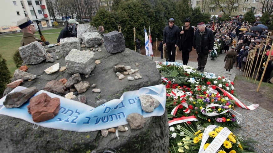 April 19, 2012: Members of Warsaws Jewish community, with  city officials and others gather to mark the 69th anniversary of the doomed Warsaw Ghetto Uprising, in Warsaw, Poland.