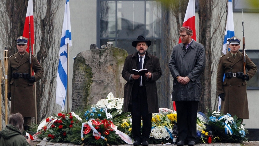 April 19, 2012: Polands Chief Rabbi Michael Schudrich,center, prays in the heart of what was once the Warsaw Ghetto during a ceremony marking the 69th anniversary of the doomed Warsaw Ghetto Uprising, in Warsaw, Poland.