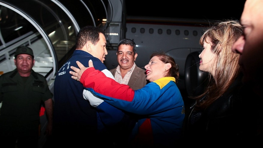 "Venezuelan President Hugo Chávez boards a plane to Cuba for radiation treatment on April 14. (<a href=""http://www.flickr.com/photos/chavezcandanga/6938673310/in/photostream"">Flickr</a>)"