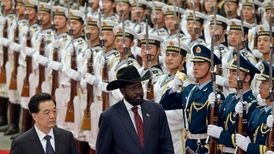 April 24, 2012: South Sudan's President Salva Kiir, right, reviews honor guard with Chinese President Hu Jintao, left, during a welcoming ceremony at the Great Hall of the People.