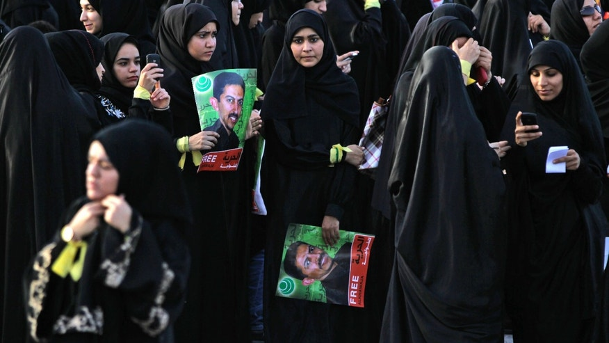 April 24: Anti-government protesters hold pictures of jailed political leader Abdulhadi al-Khawaja, who has been on a hunger strike for more than 70 days, during a march through Jidhafs, Bahrain.