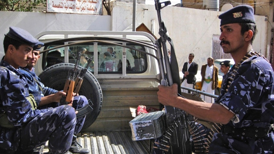 Sept. 20: Yemeni policemen guard the state security court in the capital San'a, Yemen, as the trial of four Al Qaeda suspects takes place.