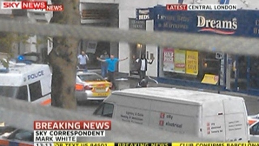 April 27, 2012: This screen grab of a SkyNews broadcast shows people being evacuated from a building in central London.