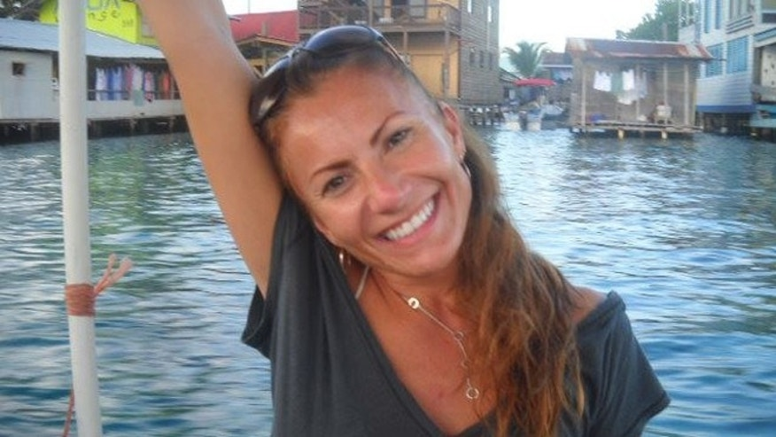 This undated photo released by Michelle Faust, sister of Yvonne Lee Baldelli, shows Yvonne Lee Baldelli in Bocas del Toro, Panama.  Panamanian and U.S. authorities are working to find the missing U.S. tourist, originally from California, who arrived to Panama in Sept. 2011 with her boyfriend Brian Brimager, according to police. (AP Photo/Michelle Faust)