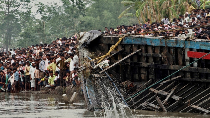 May 1, 2012: Rescuers pull out the wreckage of a ferry that capsized in the Brahmaputra River at Buraburi village, about 215 miles west of the state capital Gauhati, India.