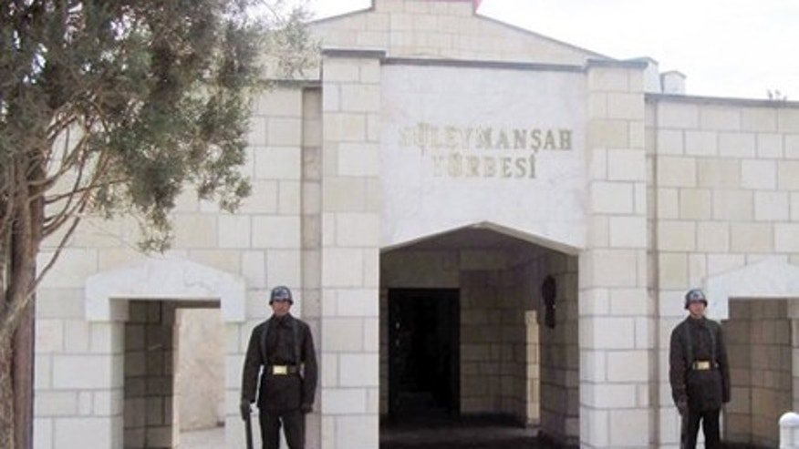 April 7, 2011: Turkish soldiers stand guard at the entrance of the memorial site of Suleyman Shah, grandfather of Osman I, founder of the Ottoman Empire, in Karakozak village, northeast of Aleppo, Syria.