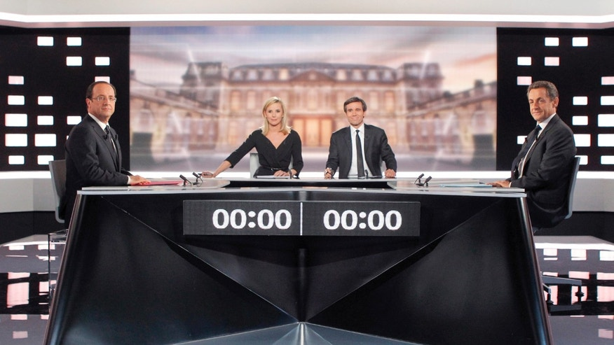 May 2, 2012: Socialist Party candidate for the presidential election Francois Hollande, left, and current President and conservative candidate for re-election Nicolas Sarkozy , right, pose before a televised debate in Paris.