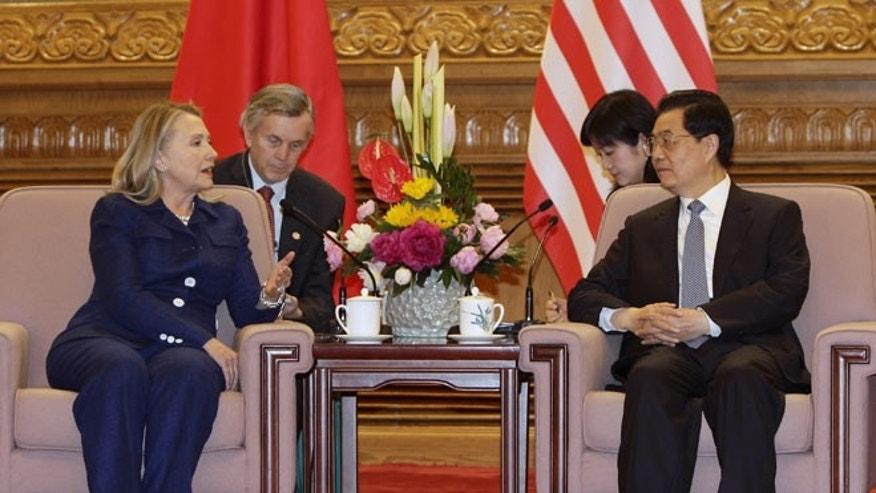 May 4, 2012: U.S. Secretary of State Hillary Rodham Clinton, left, talks to Chinese President Hu Jintao, right, during a meeting at the Great Hall of the People in Beijing.
