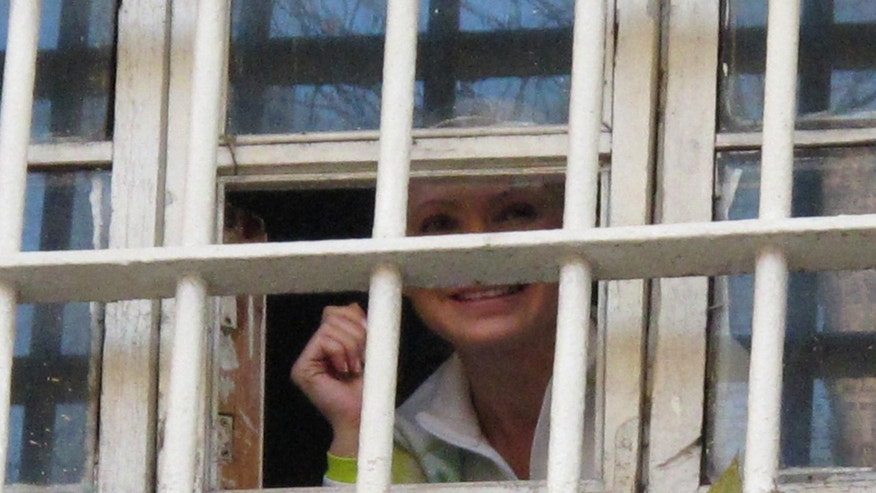 FILE 2011: Former Ukrainian Prime Minister Yulia Tymoshenko looks out from a prison window in Kiev, Ukraine.
