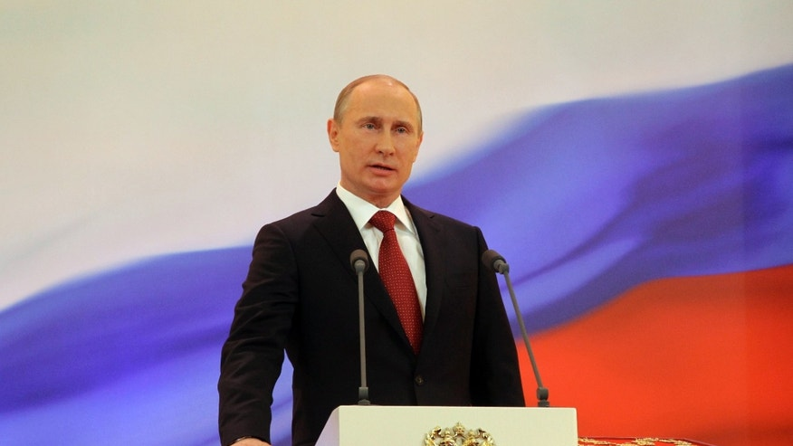 May 7, 2012: Vladimir Putin speaks with his hand on the Constitution during his inauguration ceremony as new Russia's president.