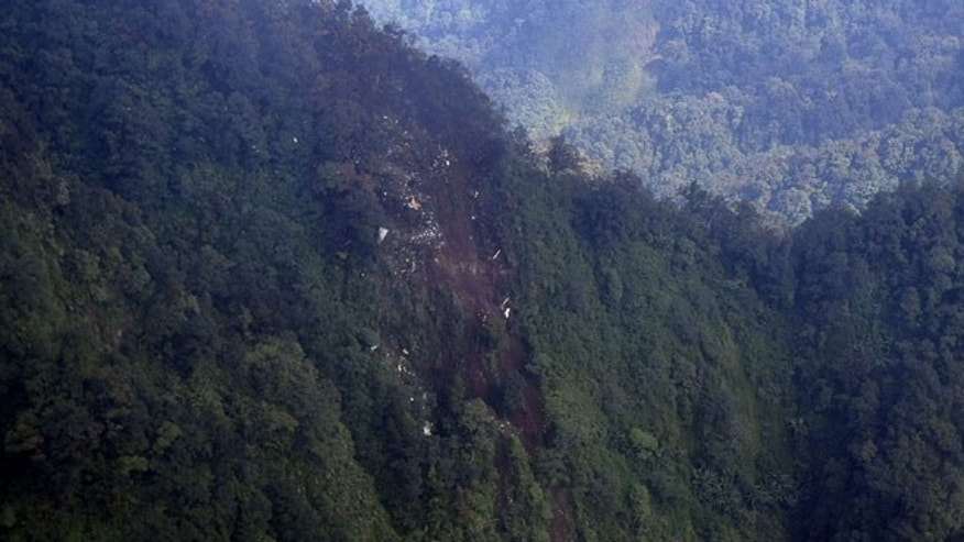 May 10, 2012: In this photo released by Indonesian Air Force, the wreckage of a missing Sukhoi Superjet-100 are scattered on the mountainside in Bogor, West Java, Indonesia.