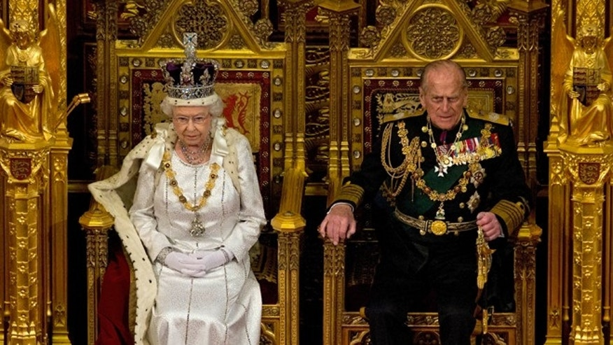 May 9, 2012: Britain's Queen Elizabeth II sits next to Prince Philip in the House of Lords as she waits to read the Queen's Speech to lawmakers in London.