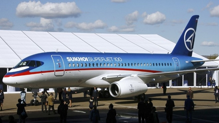 FILE - The Sukhoi Superjet-100 is displayed outside the aviation factory in Komsomolsk-on-Amur, about 3,900 miles east of Moscow, Russia's, in this Sept. 26. 2007 file photo. An official says air controllers have lost contact with the Russian-made plane similar to this one shown  May 9, 2012 carrying 46 people in western Indonesia.