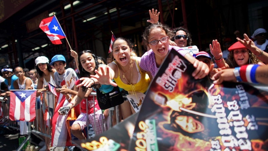 Attendants grab posters at the annual Puerto Rico Day Parade June 8, 2008 in New York City. (Photo by Yana Paskova/Getty Images)