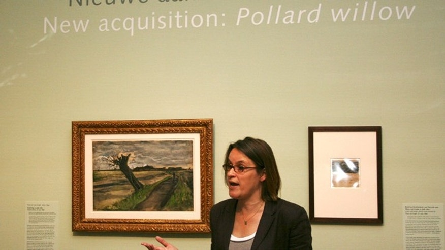 May 10, 2012: Marije Vellekoop, the museum's curator of prints and drawings, speaks near an 1882 water color of a pollard willow by Vincent van Gogh at the Van Gogh Museum in Amsterdam, Netherlands.