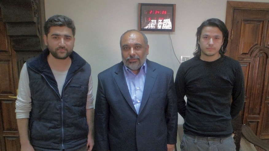 May 5, 2012: - In this file photo provided by pro-Islamic aid group known by its Turkish acronym IHH, showing Turkish journalists Adem Ozkose, left, and Hamit Coskun, right, with the IHH Chairman Bulent Yildirim, centre, in Damascus, Syria.