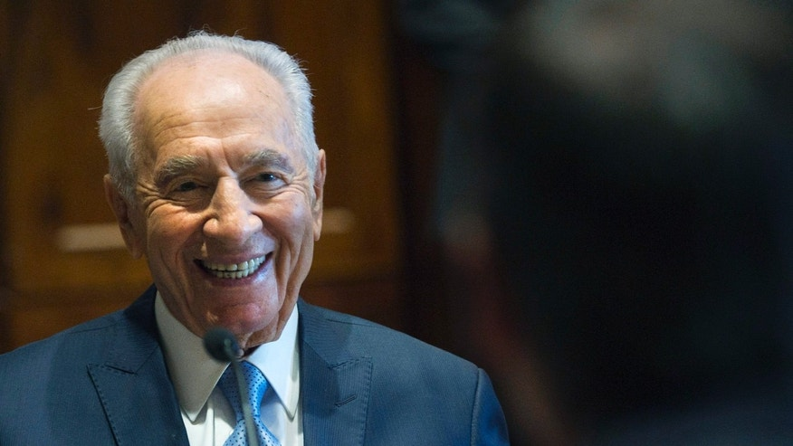 May 9, 2012: Israeli President Shimon Peres, left, share a laugh while speaking with Ontario Premier Dalton McGuinty, right, as the two meet for a discussion in Toronto.