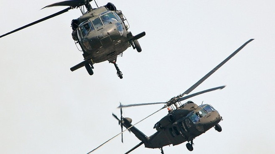 A pair of United States Army Sikorsky UH-60 Blackhawks flies past the crowd during the Combined Arms Demonstration at the Rhode Island National Guard Open House and Airshow, held at Quonset State Airport (KOQU/OQU) in North Kingstown, RI.