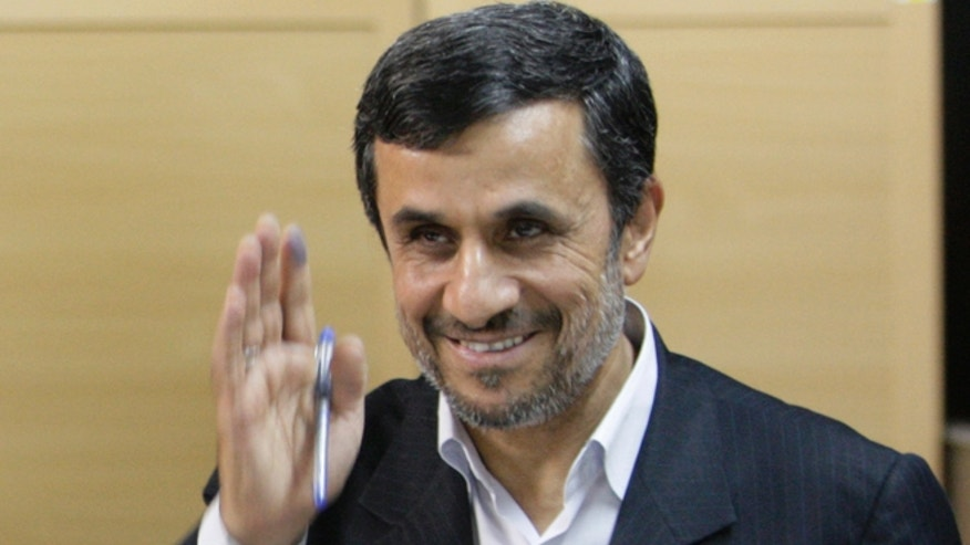 May 4, 2012: Iranian President Mahmoud Ahmadinejad waves to media after casting his vote for the parliamentary runoff elections at a polling station in Tehran, Iran.