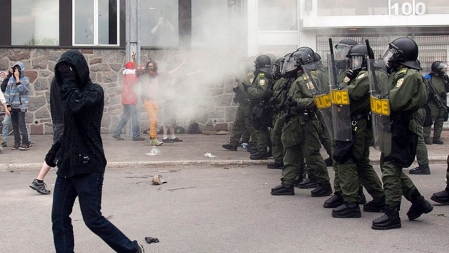 May 15, 2012: Quebec Provincial Police use tear gas to disperse students protesting against tuition hikes at the Lionel Groulx college in Ste. Therese, Quebec, Canada.