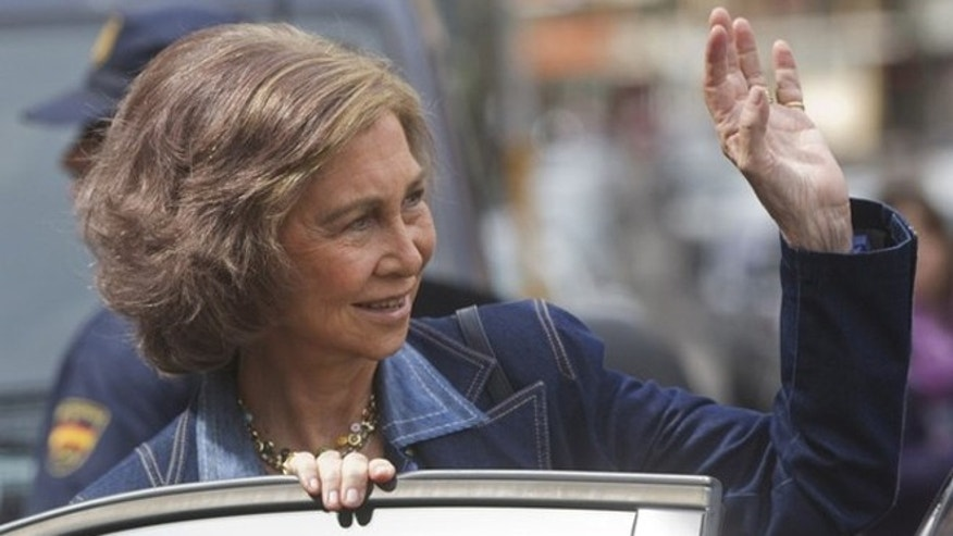 April 17, 2012: Spain's Queen Sofia waves as she leaves after visiting King Juan Carlos I at a hospital in Madrid.