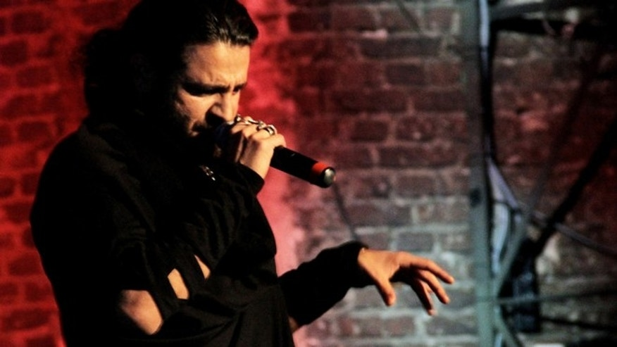 In this undated picture publicly provided by the Shahin Najafi managment,  rapper Shahin Najafi  performs in Duesseldorf , Germany.