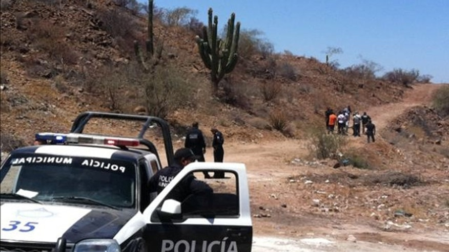 May 18, 2012: Police secure the area where the body of Mexican police reporter Marco Antonio Avila Garcia was found inside a black plastic bag on the side of a road near the city of Empalme, south of Ciudad Obregon, in Sonora state, Mexico.