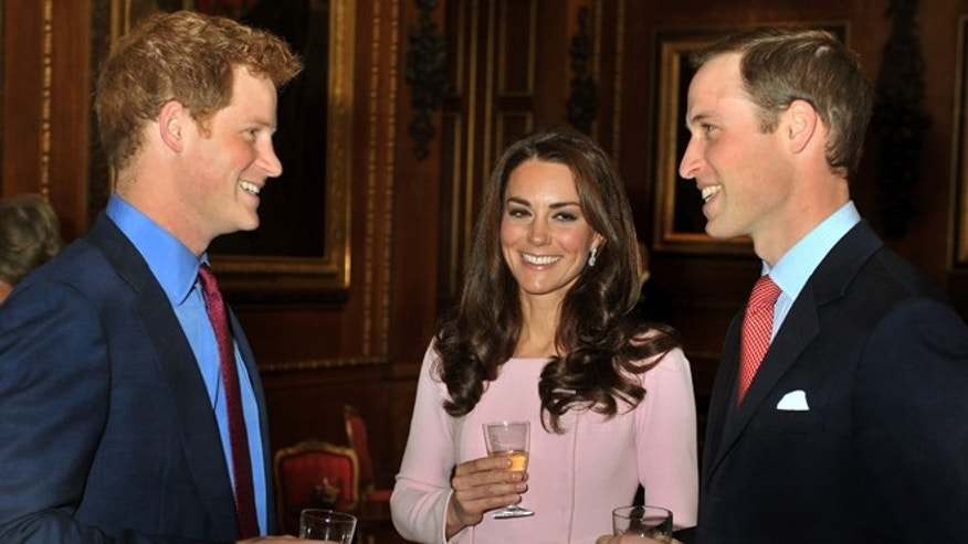 May 18, 2012: The Duke and Duchess of Cambridge talk to Prince Harry before a reception in the Waterloo Chamber, before the Queen's Monarchs Jubilee lunch at Windsor Castle.