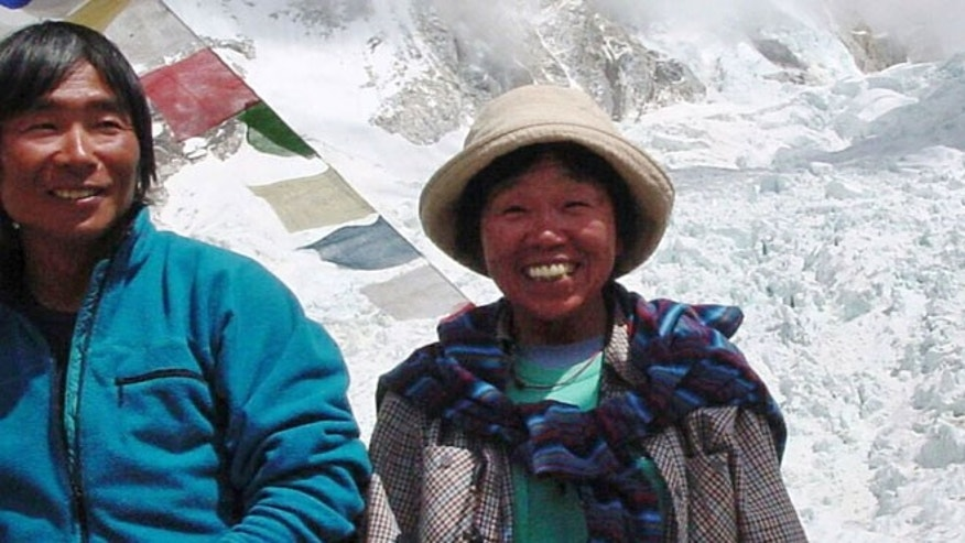 In this Thursday, May 9, 2002 file photo, Tamae Watanabe, right, of Japan poses with a photographer Noriyuki Muraguchi at a base camp on the foot of Mt. Everest in Nepal.