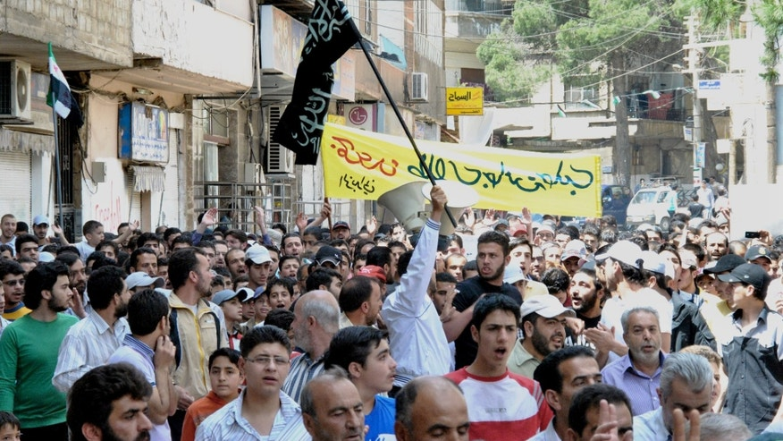 May 18, 2012: Syrians chant slogans during a demonstration in Zabadani neighborhood, Damascus, Syria. A suicide vehicle bomb tore through the parking lot of a military compound in an eastern Syrian city on Saturday, killing several in a series of blasts in recent months targeting security installations, the country's state media reported.