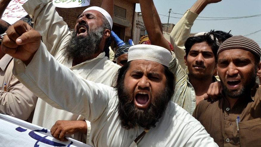 May 17, 2012: Pakistani protesters shout anti-American slogans at a rally to condemn to the reopening of the NATO supply line to neighboring Afghanistan, in Multan, Pakistan.