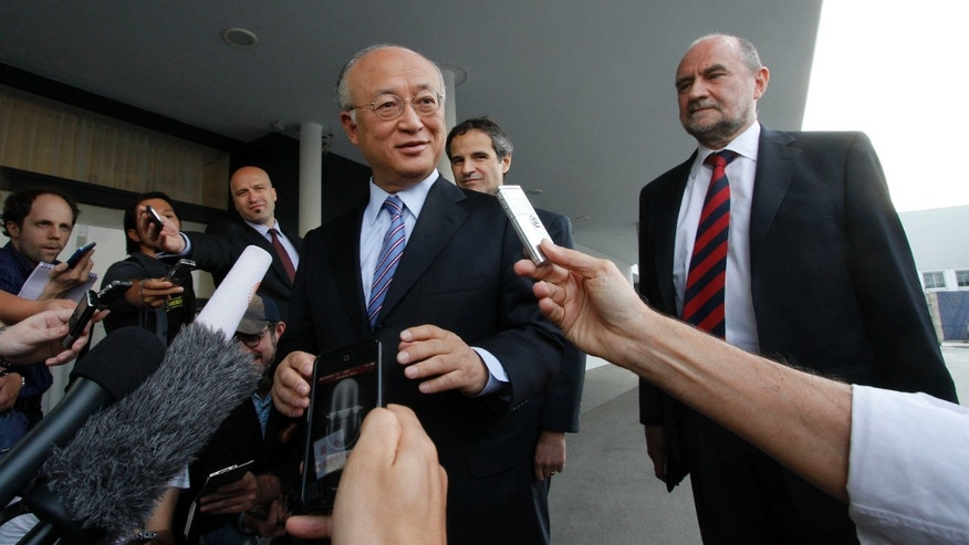 May 20, 2012: Director General of the International Atomic Energy Agency, IAEA, Yukiya Amano from Japan and Herman Nackaerts, from left, of the IAEA the chief agency official in charge of the Iran file speak to the media before his flight to Iran at the Vienna International Airport near Schwechat, Austria.