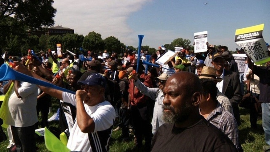May 20: Protesters make noise while Carlos Slim gives a speech at George Washington University's commencement on the National Mall in Washington D.C..