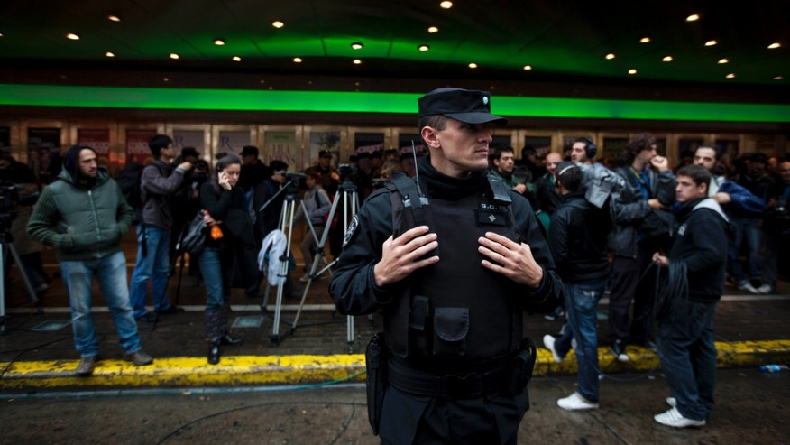 A police officer stands guard outside the Gran Rex theater in Buenos Aires, Argentina, on Tuesday. (AP Photo/Natacha Pisarenko)