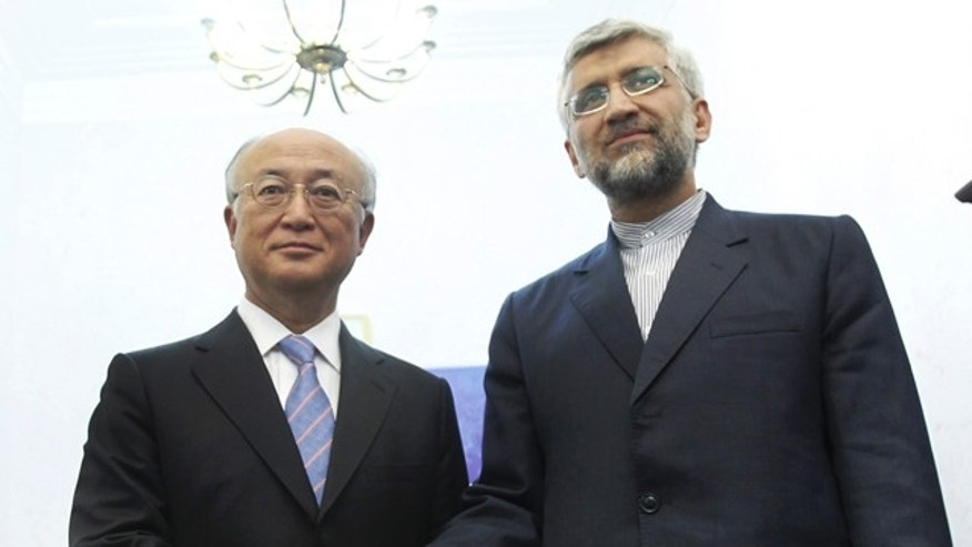 May 22, 2012: Iran's top nuclear negotiator, Saeed Jalili, right, shakes hands with International Atomic Energy Agency (IAEA) chief Yukiya Amano, at the conclusion of their meeting, in Tehran, Iran.
