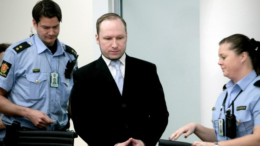May 15, 2012: Anders Behring Breivik between 2 police officers prior to taking his seat after a break in the courtroom in Oslo Tuesday morning.